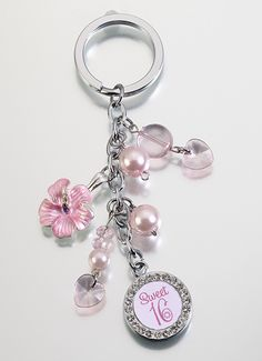 This cute Sweet Sixteen 16th Birthday Car Keys Keychain makes a great 16th Birthday gift!  Perfect for her new car keys!  The silver-plated links are decorated with hanging pink acrylic charms, a pink flower charm and off-white beads.