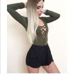 """Lace up deep V detail Bodysuit Size M available in S, and M . White, red, black & Olive green. Lace up deep V detail. Bodysuit. Brand new. Price firm unless bundled. No Lowballing bundle and save 10% when you use """"do it your self bundle tool and buy 2 or more items""""! Tops Tank Tops"""