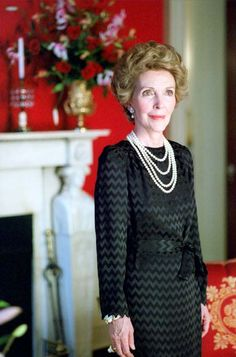 Nancy Reagan wearing a black dress during a Harper's Bazaar photo session in the Red Room of the White House. 10/25/82. http://www.reagan.utexas.edu/archives/photographs/mrs.html