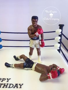 Boxing ring cake, based on a famous fight between Muhammad Ali and Sonny Liston, cake measures 14 inches and models are made from modelling chocolate and measure 7 inches.