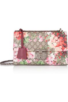 Gucci's 'Padlock' shoulder bag has a romantic, vintage feel - the iconic monogrammed canvas is printed with pink and coral blooms. This structured design has a soft suede-lined interior that's sized to fit your wallet and cell. Adjust the gunmetal chain strap to find the perfect drop. #Gucci #ValentinesDay