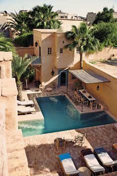 I so love this building, the pool and poolside entertaining area at this hotel in Morocco. From the stylefiles.com
