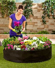 """Conveniently create your own pop-up garden with this Outdoor Planter Bed Bag. Pour soil into the unfolded, felt bag and plant flowers, fruits, vegetables, herbs and more. Small, 13"""" dia. x 9-1/4""""H. Large, 49-1/2"""" dia. x 11-3/4""""H."""