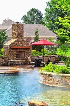 A poolside fireplace and dining area creates the perfect spot to entertain family and friends.