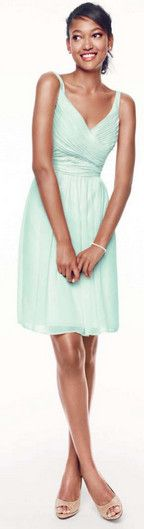 Short, airy and chic, your bridesmaids will look amazing in this spectacular chiffon dress! An ultra-feminine V-neck pairs with a sleeveless, ruched bodice for the ultimate in figure flattery. David's Bridal Bridesmaid Dress Style F15603. Pictured in Mint. Available in all David's Bridal colors.