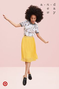 This midi-length, yellow pleated skirt and patterned, burnout velvet top makes for a cheery outfit.