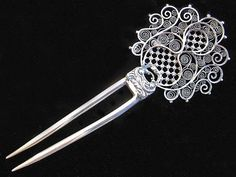 Lovely silver Victorian hair pin with filigree, cutwork, and scrollwork. Sterling.