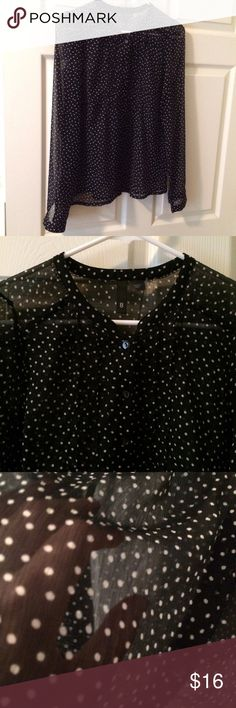 "Black see through polka dot button down Gorgeous see through black with white polka dot button down by H&M, With pleated front. Measurements : shoulders 16"", armpit to armpit 19"", length 23"". 100% polyester. H&M Tops Button Down Shirts"