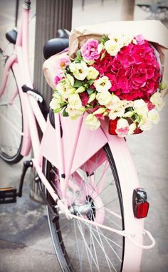 Pink Bicycle With Basket Of Flowers