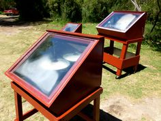 Solar oven idea. Looks like they have a double glazed top that is fixed, with access inside from the back. No reflectors, but I guess that can be added if needed. Inside is painted black.
