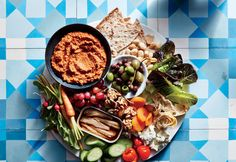 "Chunky Muhammara | This classic dip originally hails from Syria and gets much of its robust flavor from toasty Aleppo pepper. It also includes roasted sweet red bell peppers, tannic and meaty toasted walnuts, and tart pomegranate molasses, which you can find at Mediterranean or Middle Eastern markets. You can process it until completely smooth, but we like leaving some small chunks of walnuts for more texture. Build a healthy ""snack dinner"" with this dip at the center—surround it with…"