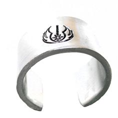 Ready are you? This adjustable, sturdy, wide aluminum ring has been stamped by hand with our very own exclusive Jedi symbol design stamp. This makes a fan Hand Stamped Jewelry, Handmade Jewelry, Unique Jewelry, Jedi Symbol, Star Wars Ring, Symbol Design, Thumb Rings, Symbols, Pure Products