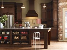 Choosing timeless dark Cherry kitchen cabinets and accenting them with aged elements, like seeded glass and oil rubbed bronze hardware, are key to holding tight to the past. Menards Kitchen Cabinets, Schrock Cabinets, Wood Kitchen Island, Wood Cabinets, Kitchen Cabinetry, Kitchen Islands, Kitchen And Bath Showroom, Kitchen Sale, Cherry Kitchen