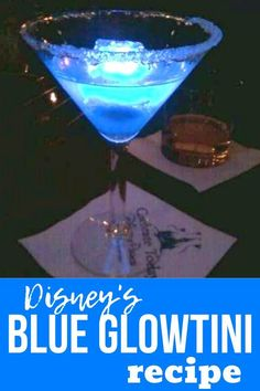 Make the famous Disney Blue Glowtini at home with this easy recipe! Disney recipes for cocktails are a great way to relive your vacation once you are back at home from Disney World or Disneyland. Disney World Tips And Tricks, Disney Tips, Disney Recipes, Disney Cocktails, Cocktail Drinks, Liquor Drinks, Halloween Cocktails, Alcoholic Beverages, Cocktail Recipes