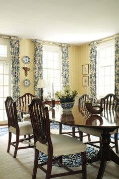 Love the pale walls with the yellow & blue toile. Great idea covering the curtain rods and finials.