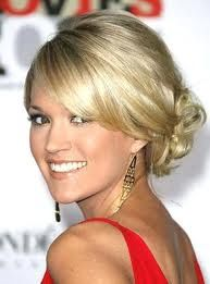 Blonde with curly side chignon updo and side swept bangs hairstyle