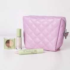 Quilted Makeup Bag, $18. Travel in style with the quilted faux-leather makeup bag with wipeable interior & cute fairy zipper charm.