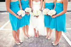 Bright blue bridesmaid dresses; short chiffon bridesmaid dresses with a sweetheart neckline, white shoes, and white bouquets.  I am so glad we chose malibu blue! It looks so good with white!