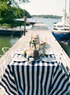 Use navy and white striped tableclothes for your reception tables. If flowers are being used for the centerpieces, I would suggest sticking with white flowers so it doesn't look like you got carried away with the red, white, and blue theme.