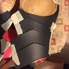 Some progresso soup on my Nidalee breastplate! I haven't been posting progress pics but the countdown is on!! Can't wait to go home to finish working this baby. Praying I can finish for East Coast. Using my duct tape dummy made my life easier in terms of pattern making. I was able to get a really close fit and I'm so proud of how clean the pattern came out.  Worbla base (2mm red craft foam with the sandwich method) 4mm eva foam for details. by sun_z