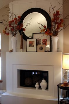 Beautiful Styling! Round Mirror, tall vases on both sides and layered art! #S3