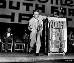 Rev. Billy Graham in his early days preaching for Youth for Christ