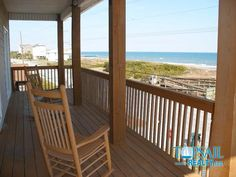 Covered porch, rocking chairs, and ocean views at Callalily