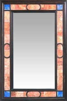 A SPANISH STYLE PIETRA DURA INSET MIRROR The ebonized wood