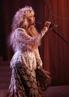 Stevie ~ ☆♥❤♥☆ ~  in a stunning stage outfit, and with beautiful fluffy long hair, performing 'Seven Wonders' with the other members of Fleetwood Mac     ~   https://youtu.be/9b4F_ppjnKU