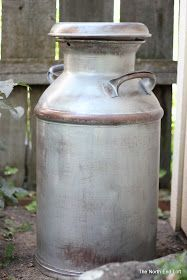 The North End Loft: Old Painted Milk Can. Cool way to keep the distressed look