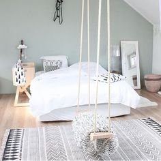 Whimsical rope swing in a modern Scandinavian bedroom.