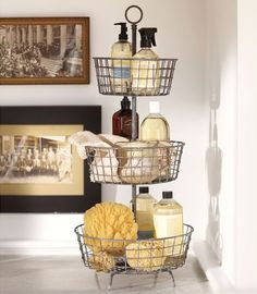 A tiered bath storage system is practical. You can use each level for a specific category of objects.
