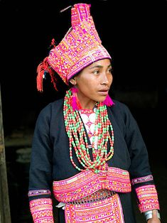A married Ko Pala ethnic minority woman wears her traditional costume at home Ban Honglerk Phongsaly Province Lao PDR The brightly coloured... Laos, Captain Hat, Ethnic, Winter Hats, Women Wear, Costumes, Traditional, Woman, People
