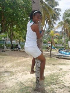 1993-present (forever): An island girl (from Jamaica) with a passion for smiling and attempting to climb trees and sing #Jamaica #palmtree #climb #beach