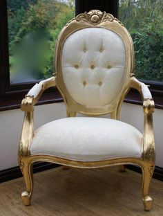 gold and white arm chair.