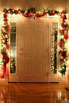 Inside the front door. Garland with lights, ornaments, and red tule