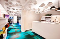 Extravagant Hotel Interior in Playful and Luminous Design : Imposing Display With Simple Modern Shelving Units In White Supported With Astonishing Ceiling Lamps For Alluring Interior