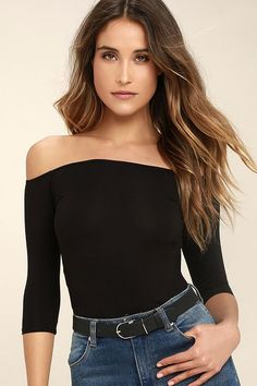 Give 'em a wink, that pretty smile, and a little shoulder in the Upstage Black Off-the-Shoulder Top!