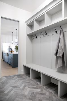 Who wouldn't love to have this beautiful grey herringbone tile in their mudroom? Mudroom Laundry Room, Laundry Room Remodel, Bench Mudroom, Kitchen Remodel, Laundry Room Floors, Mud Room Lockers, Mudroom Cabinets, Laundry Room Design, Storage Cabinets