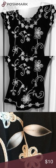 Embroidered shirt This pretty embroidered shirt is classy yet casual. It tapers in at the waist and sits just right on the hips. Great condition and from a non smokers home Lauren Michelle Tops Blouses