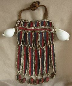 Papua New Guinea | Man's pectorial from the Highlands region, worn during ceremonial occasions | Plant fiber, dyed pigment, studded with nassa shells, and large white cowrie shells | ca. pre 1940.