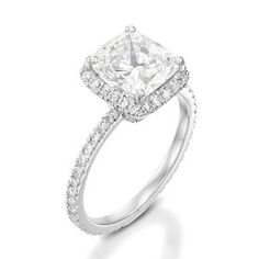 This is a mount ring, prongs with an encircle pave, including a cluster pave on the band. Set with  diamonds.Ring particulars The ring is set with 71 diamonds. The center diamond is a pear shape, white color in ranges of F-G, clarity is eye clean in ranges of VS-SI, the average total carat weight is 2.00 carat. The diamonds set in the ring paves are 70 round brilliant cut. White color in ranges of F-G, clarity is eye clean in ranges of VS-SI, total carat weight is 0.60 carat.What's my ring…