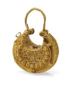 "Listed as ""A Fatimid gold earring, Egypt or Syria, circa 11th century"".  Have a look at it. How the hell could you get that through your ear?  Look at the hole in the center of the hollow opening.  It's for putting something in. Possibly Perfume?"