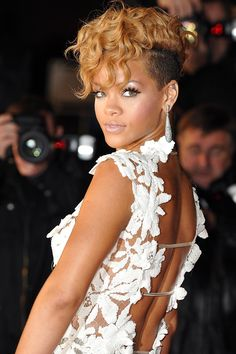 #Rihanna's #BeautyTransformation  - HarpersBAZAAR.com  Isn't this cut and Colour to die for? Love this golden hue with #tapered sides!