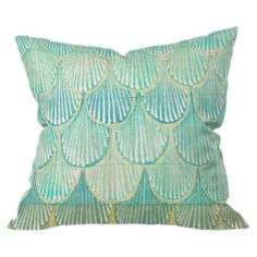 Add a pop of color to your favorite arm chair or chaise with this eye-catching pillow, showcasing a turquoise scallop motif for lovely appeal.