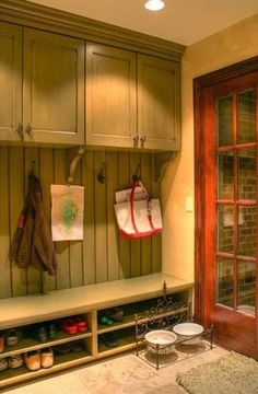 This built-in storage project would be very easy to DIY. Simply clad the wall in bead-board or paneling and hang a few unfinished upper cabinets purchased from a furniture warehouse up top. Use homemade wood boxes with shelves for seating and shoe storage. Add crown molding and paint to add character and the finishing touch. Don't forget to screw in coat hooks and cabinet door hardware.