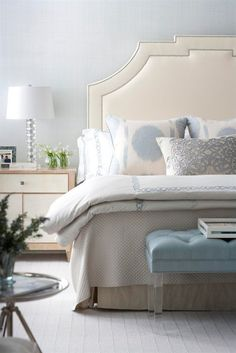 Great, soothing pallet but what gives this the real designer look is the very high upholstered headboard.  Often a few things done in larger scale add drama where lots of little stuff won't.  CL