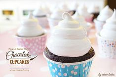Peanut Butter filled Chocolate Cupcakes topped with heavenly Marshmallow Frosting - niner bakes // ninerbakes.com