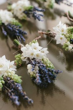 Simple chic boutonnieres are made of tiny white flowers and lavender.                                                                                                                                                                                 Más
