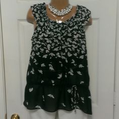 Black and white floral print sheer blouse size med This black and white blouse is in great condition with some stretching in the elastic. It can be worn on the shoulder or slightly off the shoulder. This listing is for the blouse only. Cato Tops Blouses